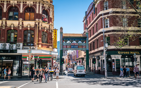 3rd January 2019, Melbourne Australia: People walking and Chinatown entrance arches on Little Bourke Street in Melbourne Australia