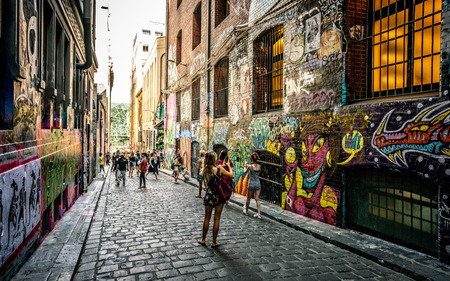 3rd January 2019, Melbourne Australia : Hosier lane view with dramatic sunset light and lot of tourists taking pictures in Melbourne Australia