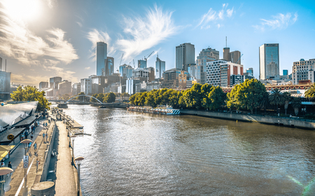 2nd January 2019, Melbourne Australia : Yarra river view in central Melbourne with riverbank promenade and Melbourne CBD skyline in Victoria Australia