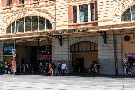 2nd January 2019, Melbourne Australia : Close-up view of the entrance of Flinders street station with the name written and people in Melbourne Victoria Australia