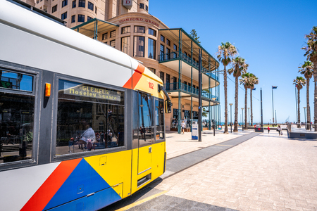 31st December 2018 , Glenelg Adelaide South Australia : Adelaide tram at the terminus at Moseley square in Glenelg and view of the beach and jetty in the distance in Glenelg SA Australia