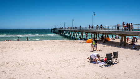 31st December 2018 , Glenelg Adelaide South Australia : Glenelg jetty and beach view with people on sunny summer day with clear blue sky in Glenelg SA Australia