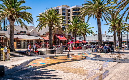 31st December 2018 , Glenelg Adelaide South Australia : Moseley square view on hot sunny summer day with kids playing in the water fountain in Glenelg SA Australia 写真素材 - 119558098