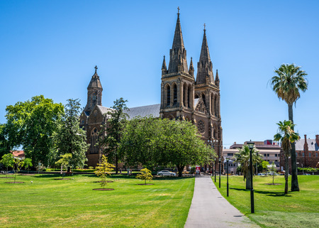 31st December 2018, Adelaide South Australia : Side view of St. Peters Cathedral an Anglican cathedral church and Creswell Gardens green park in Adelaide SA Australia