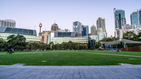 23rd December 2018, Sydney NSW Australia : Grassy place at Tumbalong park at dusk with Sydney skyline in background in Darling Harbour NSW Australia 写真素材 - 119558148