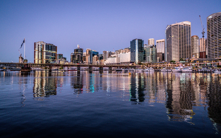 23rd December 2018, Sydney NSW Australia : Scenic night view of Sydney Darling Harbour with Pyrmont bridge and skyline