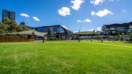 23rd December 2018, Sydney NSW Australia : Grassy place at Tumbalong park with people in Darling Harbour Sydney Australia