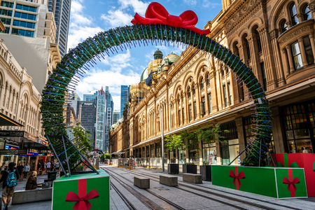 23rd December 2018, Sydney NSW Australia : Sydney Christmas decoration on George street framing a view of the Queen Victoria Building or QVB in Sydney NSW Australia