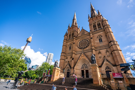23rd December 2018, Sydney NSW Australia : St Marys Cathedral wide angle front view and Sydney tower eye in Sydney NSW Australia 報道画像