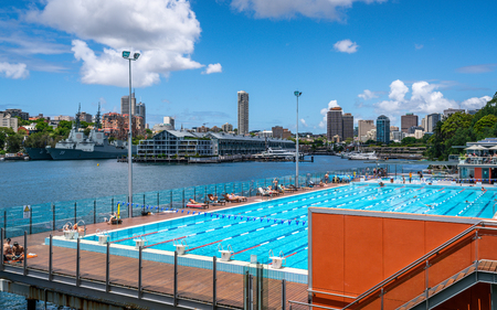 23rd December 2018, Sydney NSW Australia : View of outdoor Andrew Boy Charlton Pool with people and Woolloomooloo Finger Wharf and bay in background in Sydney NSW Australia 報道画像