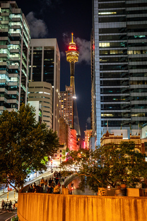 23rd December 2018, Sydney NSW Australia : Vertical night view of Sydney tower eye from market street with people in Sydney NSW Australia