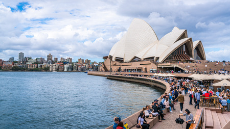 22nd December 2018, Sydney NSW Australia : Front view of the Sydney Opera House with bar and promenade full of people in Sydney NSW Australia 写真素材 - 119558184