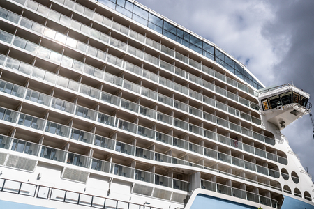 Details of a giant cruise ship showing the lots of cabins balconies