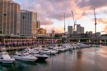 22nd December 2018, Sydney NSW Australia : Sunset on Darling Harbour marina with yachts boats in Sydney NSW Australia