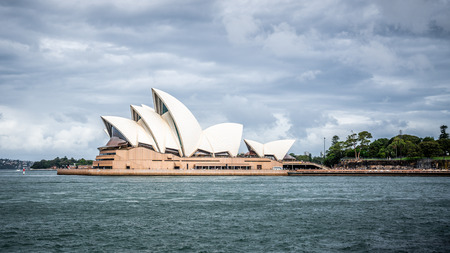 22nd December 2018, Sydney NSW Australia : Scenic view of Sydney Opera house with overcast stormy weather in Sydney NSW Australia