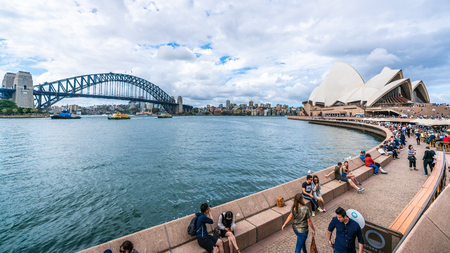 22nd December 2018, Sydney NSW Australia : Wide angle view of the promenade leading to Sydney Opera House with people and Harbour bridge in Sydney NSW Australia