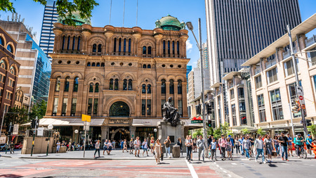 23rd December 2018, Sydney NSW Australia : Facade view of the Queen Victoria Building or QVB with lot of people crossing the road in Sydney NSW Australia