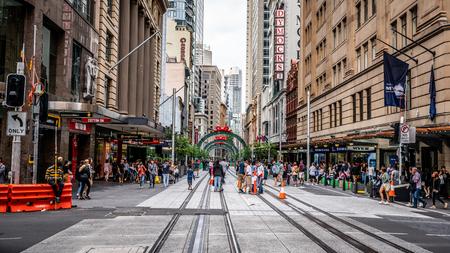 23rd December 2018, Sydney NSW Australia : Streetview of George street with people walking on tram rails in Sydney NSW Australia 写真素材 - 119558296