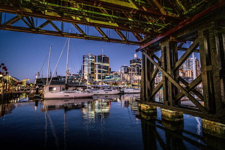 23rd December 2018, Sydney NSW Australia : Details of Pyrmont bridge pier and Darling Harbour marina at night in Sydney NSW Australia 報道画像