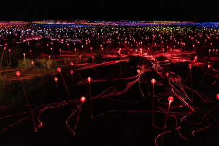 Field of light at night with mostly red lights in NT Australia 写真素材