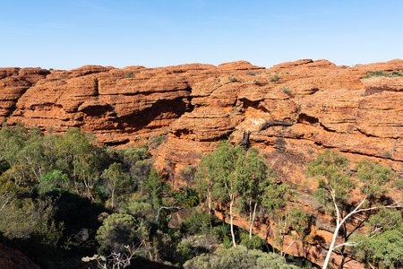 Kings canyon landscape with red sandstone domes and staircases pathway during the Rim walk in NT outback Australia 写真素材