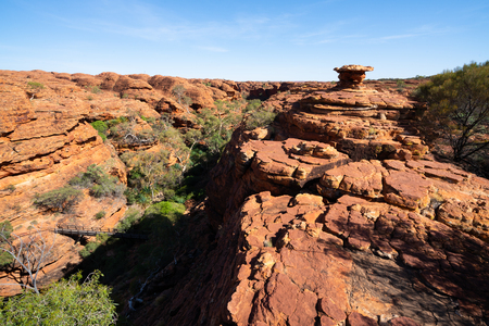 Kings canyon scenic panorama with huge cliffs during the Rim walk in NT outback Australia