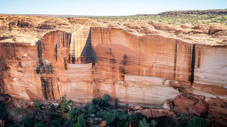 View of the huge cliffs walls of Kings Canyon in Northern Territory outback Australia