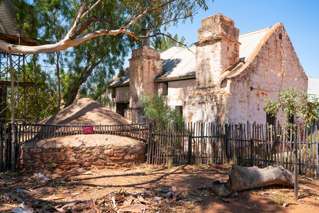 Hermannsburg view with old underground water tank and old house in NT Australia
