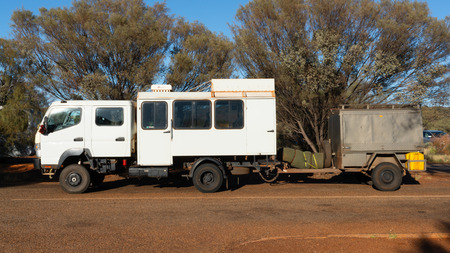 Side view of a 4WD safari truck with trailer in outback Australia
