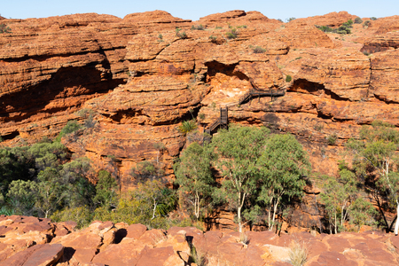 Kings canyon landscape with red sandstone domes and staircases pathway during the Rim walk in NT outback Australia 写真素材 - 123338568