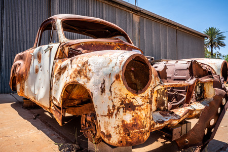 Vintage rusty car wreck in Australian outback red centre