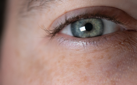 Blue green caucasian man eye close-up view