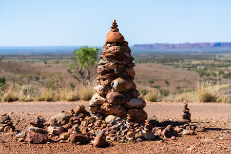 Close-up view of a Cairn in middle of Outback NT Australia in the red centre