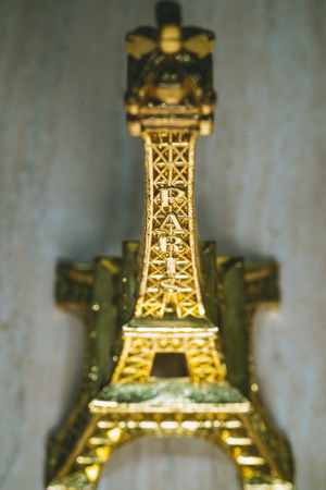 Golden Mini Eiffel Tower a souvenir from Paris France 写真素材