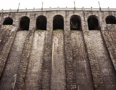 Bottom view of an old brick dam in Lushan mountains Jiangxi China 写真素材 - 123339777
