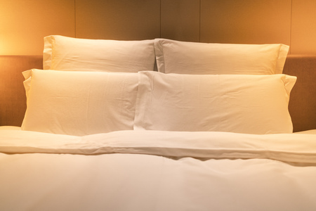 White sheets king size bed with double pillows and warm light 写真素材 - 123339783