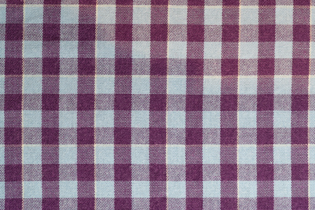 Full frame cotton check purple and blue fabric background