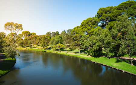 Torrens river and riverbank garden and promenade view in Adelaide SA Australia 写真素材
