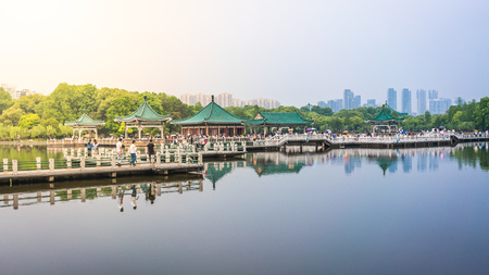 Wuhan Donghu east lake view with Chinese pavilion and dramatic light in Wuhan Hubei China 写真素材