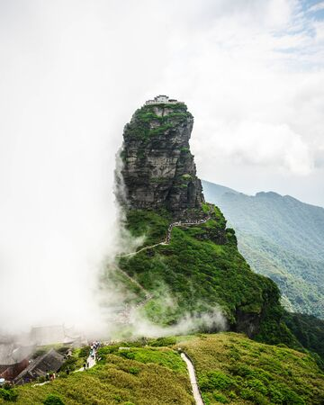 Fanjingshan mountain scenery with view of the red cloud golden peak with Buddhist temple on the top in the clouds in Guizhou China