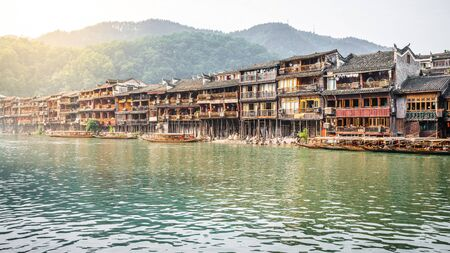 Old Chinese houses on riverside in Fenghuang ancient town in Hunan China