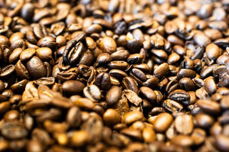 Roasted coffee beans background close up view