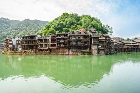 Old traditional houses on riverside landscape in Fenghuang ancient phoenix town in Hunan China
