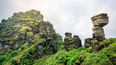 Mushroom shaped stone and view of the old golden summit in Fanjing mountain in Guizhou China Stok Fotoğraf