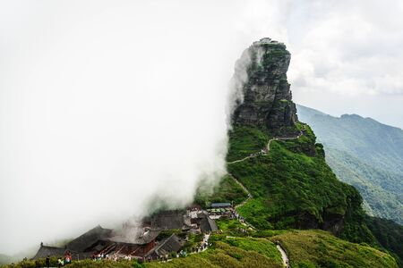 Fanjingshan mountain scenery with view of the new golden summit with Buddhist temple on the top in the clouds in Guizhou China