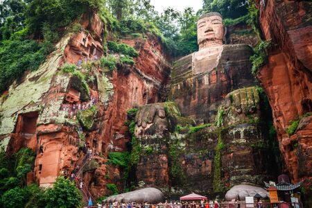 Full view of the Leshan Giant Buddha or Dafo from river boat in Leshan Sichuan China