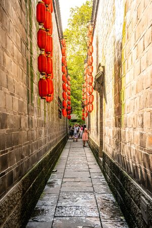 Narrow alley with red Chinese lanterns at Jinli ancient town in Chengdu Sichuan China