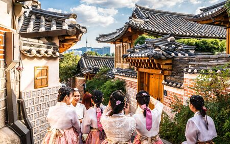 Seoul Korea , 23 September 2019 : Group of Asian tourists girls in traditional Korean Hanbok dressing at Bukchon Hanok village in Seoul South Korea