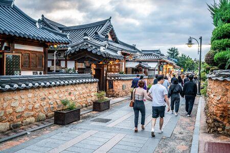 Jeonju Korea, 5 October 2019 : Tourists walking in an alley of Jeonju Hanok village Maeul on a cloudy day in South Korea