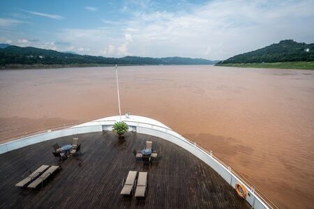 Front of a cruise ship on muddy Yangtze river during summertime in China